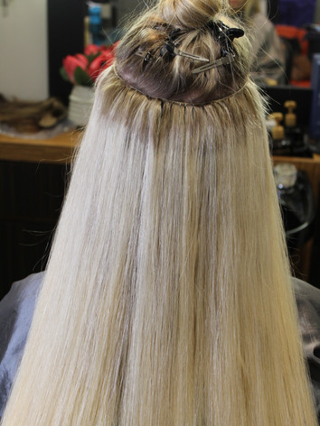 Top row of custom colored Bohyme Luxe Hand tied wefts