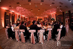wedding reception indoors chair sashes bows lighting event bride groom