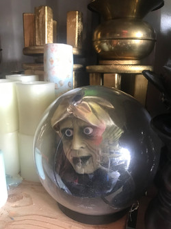 candles gold stands globe spooky face