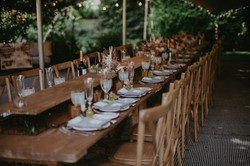 rustic trestles and crossback chairs