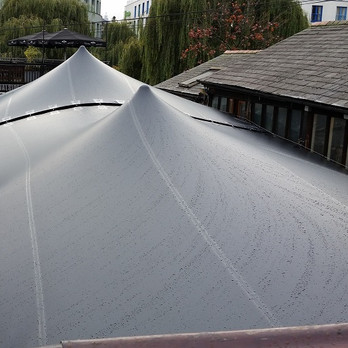 3 joined black stretch tents Camden