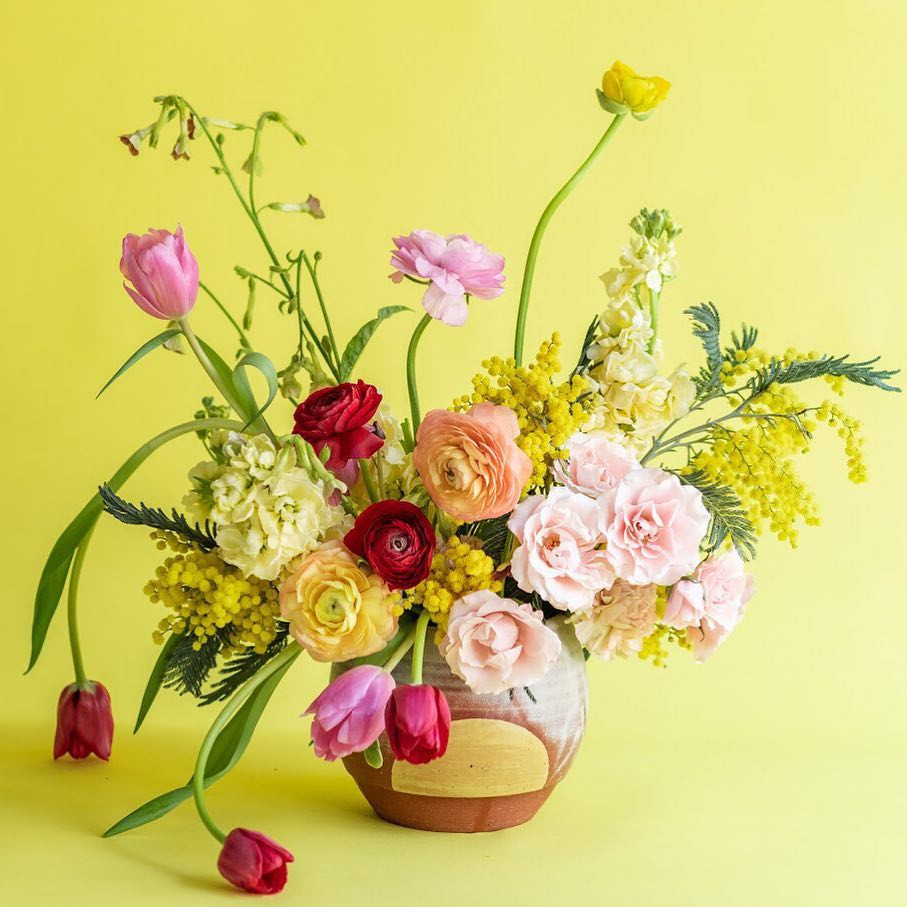 Osa Atoe's pot with flower arrangement by Pistil and Stamen