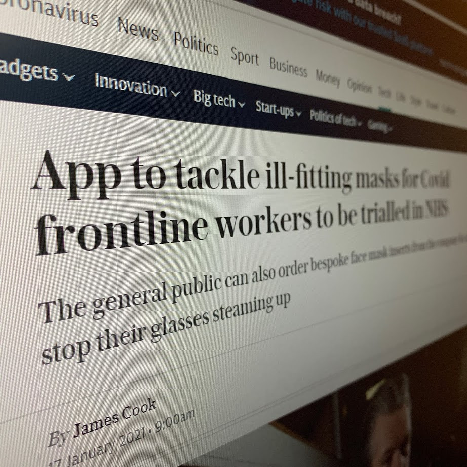 Photograph of a computer screen with a newspaper headline on it.