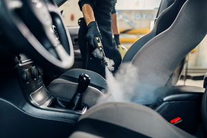 carwash-worker-cleans-seats-with-steam-c