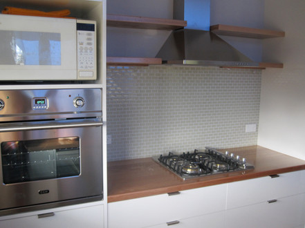 floating timber shelves with gass mosaic tiles