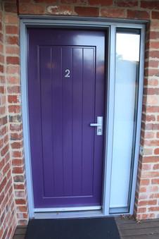 Purple entry door.