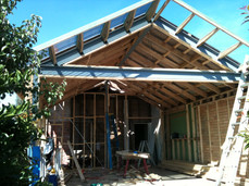 steel portal frame to allow for a large window and bi fold doors