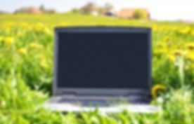 green-environmental-laptop-in-field.jpg