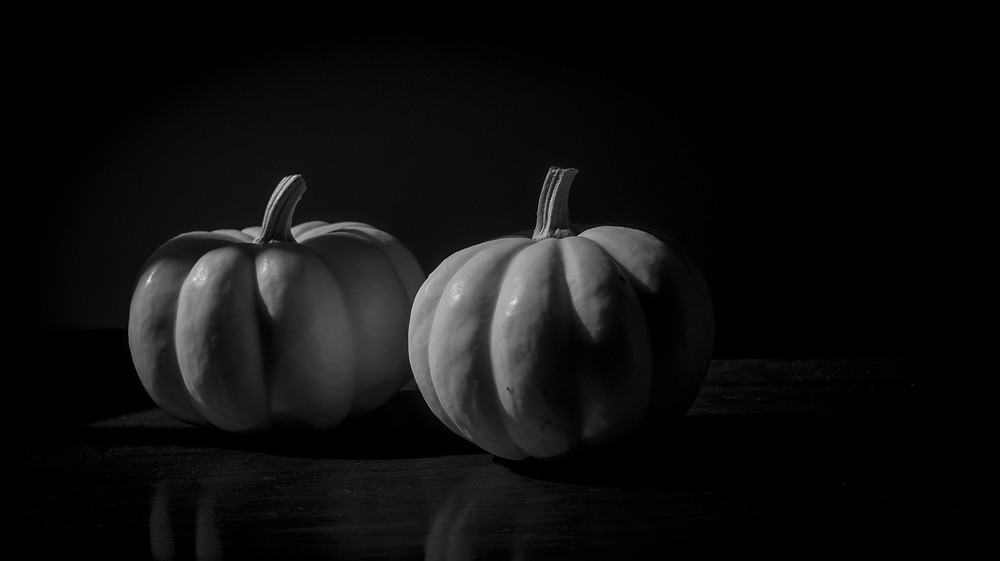 Black and white still life photograph white pumpkins