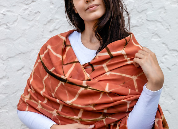 hand-made clamp-dyed shibori stole worn across shoulders