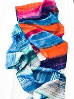 Two handpainted silk scarves