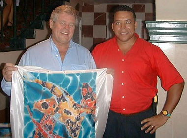 "Jean-Baptiste presenting an original to Gordon ""butch"" Stewart"