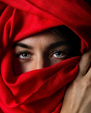 photo-of-person-covered-by-red-headscarf