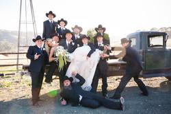 fun bride with cowboy groomsmen