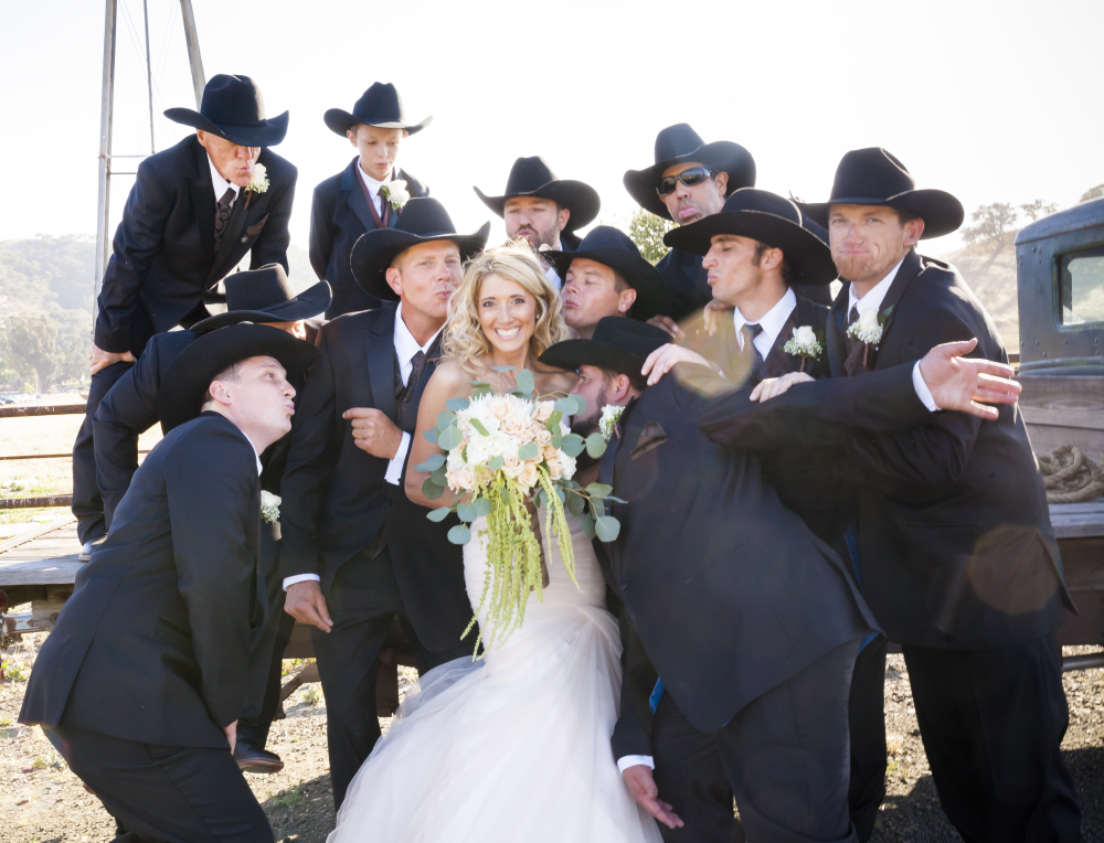 bride with cowboy groomsmen