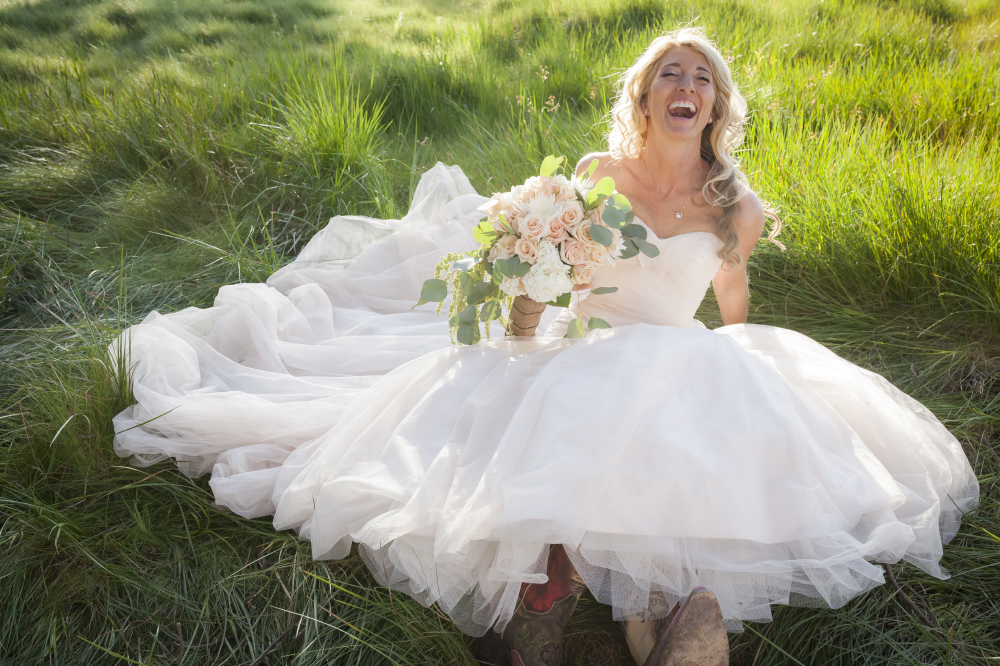 candid laughing bride in grass