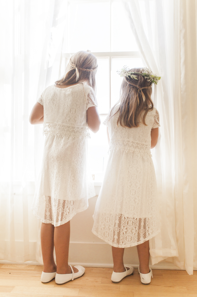 flower girls peeking out window