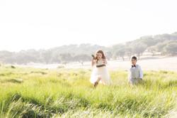 flowergirl running through field