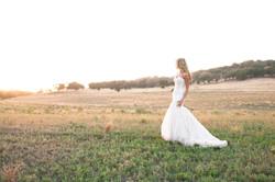 bride in sunset field