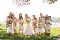 ranch bridesmaids in grass field