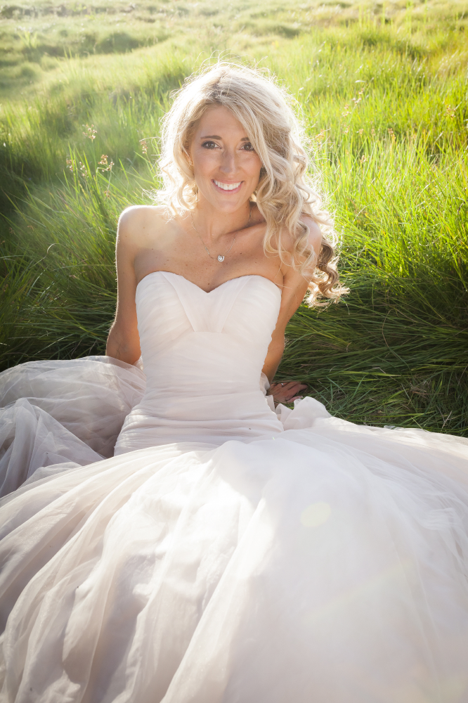 beautiful bride in grass portrait