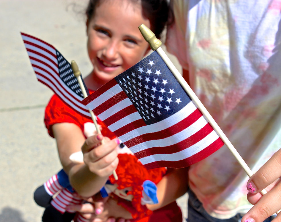 Students waving small American flags at private school in Las Vegas, NV