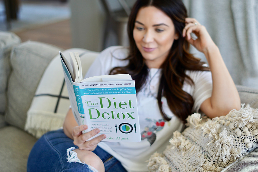 Woman reading The Diet Detox Book