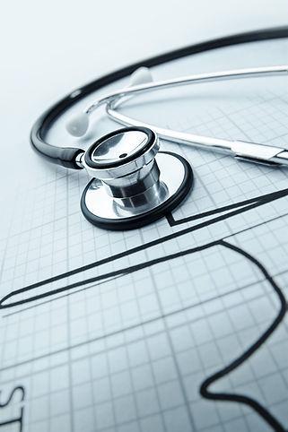 Stethoscope on electrocardiogram printout printout