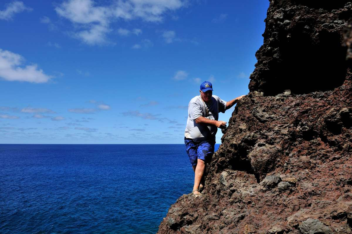 Climbing down the cliffs to the cave at The Gods