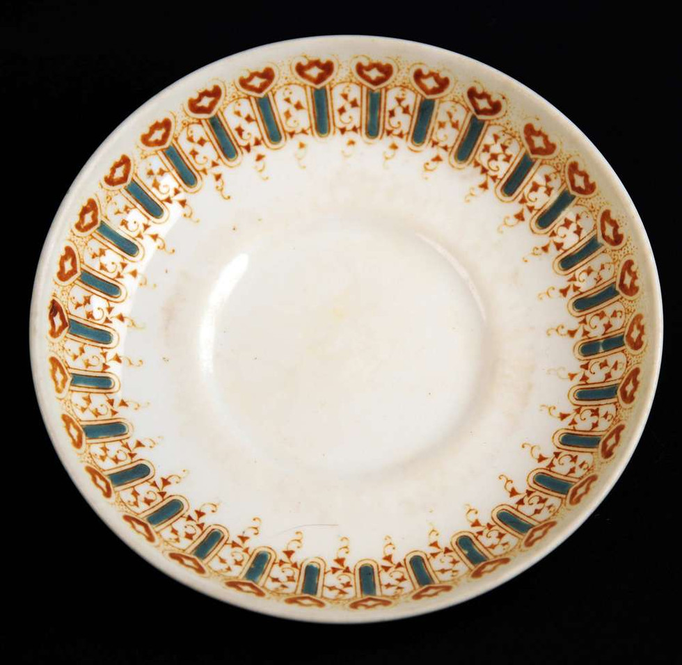 Turquoise pattern first class saucer with the White Star Line logo removed. It is believed the logo's were removed when the Cunard Line purchased the White Star Line