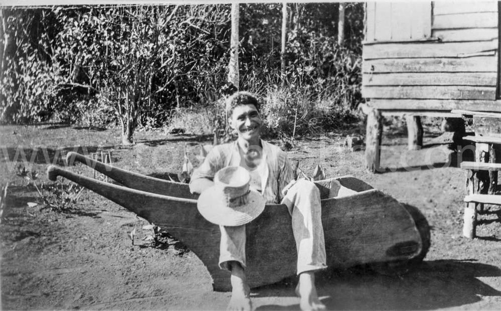 1931 Fred Christian resting in island wheelbarrow
