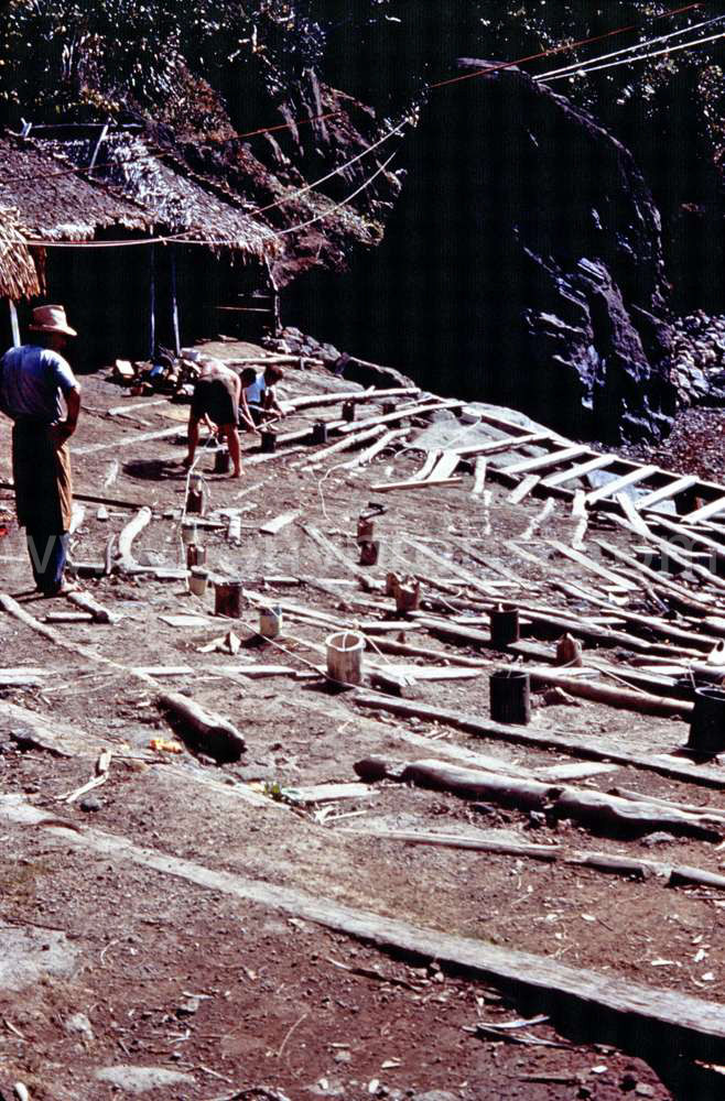 1957 Building charges of Dynamite in old paint cans to deepen Bounty bay