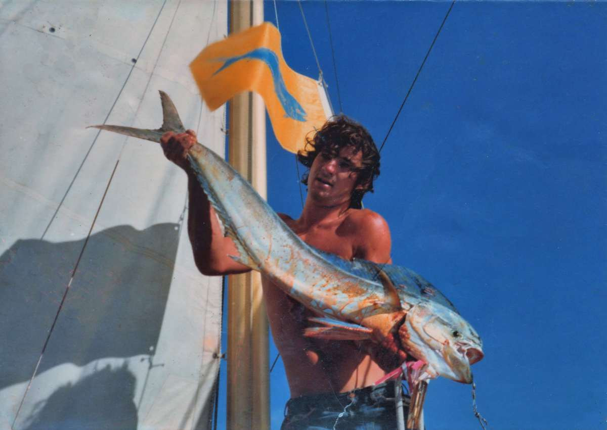 Tony with a Mahi Mahi sailing from Hawaii to Canada Julyl 1977