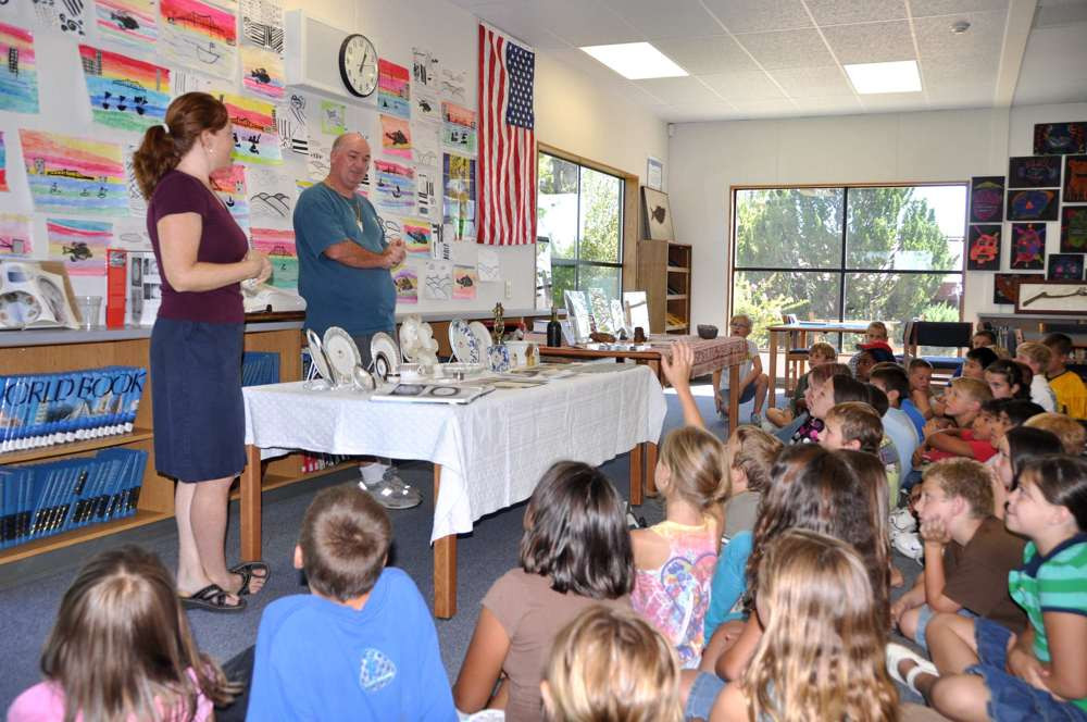 Tony Probst showing his Titanic collection to school children in Sonora, CA