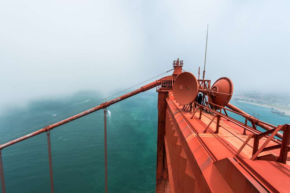 A passing cloud or fog on top of the Golden Gate Bridge