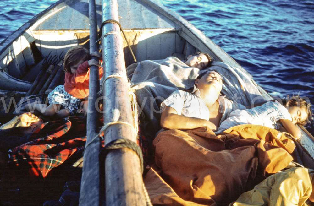1957 Sailing to Oeno Diane Clark holding mast. Right side front to back Pat Young, Ivan Christian, Brenda Christian