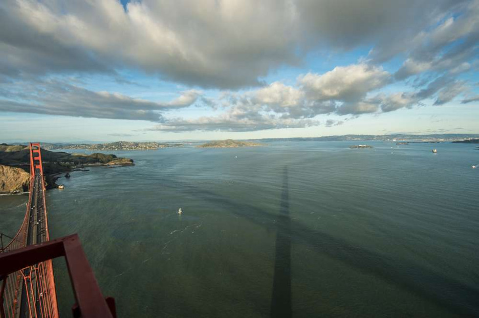 Shadow of the Golden Gate Bridge over San Francisco Bay just before sunset