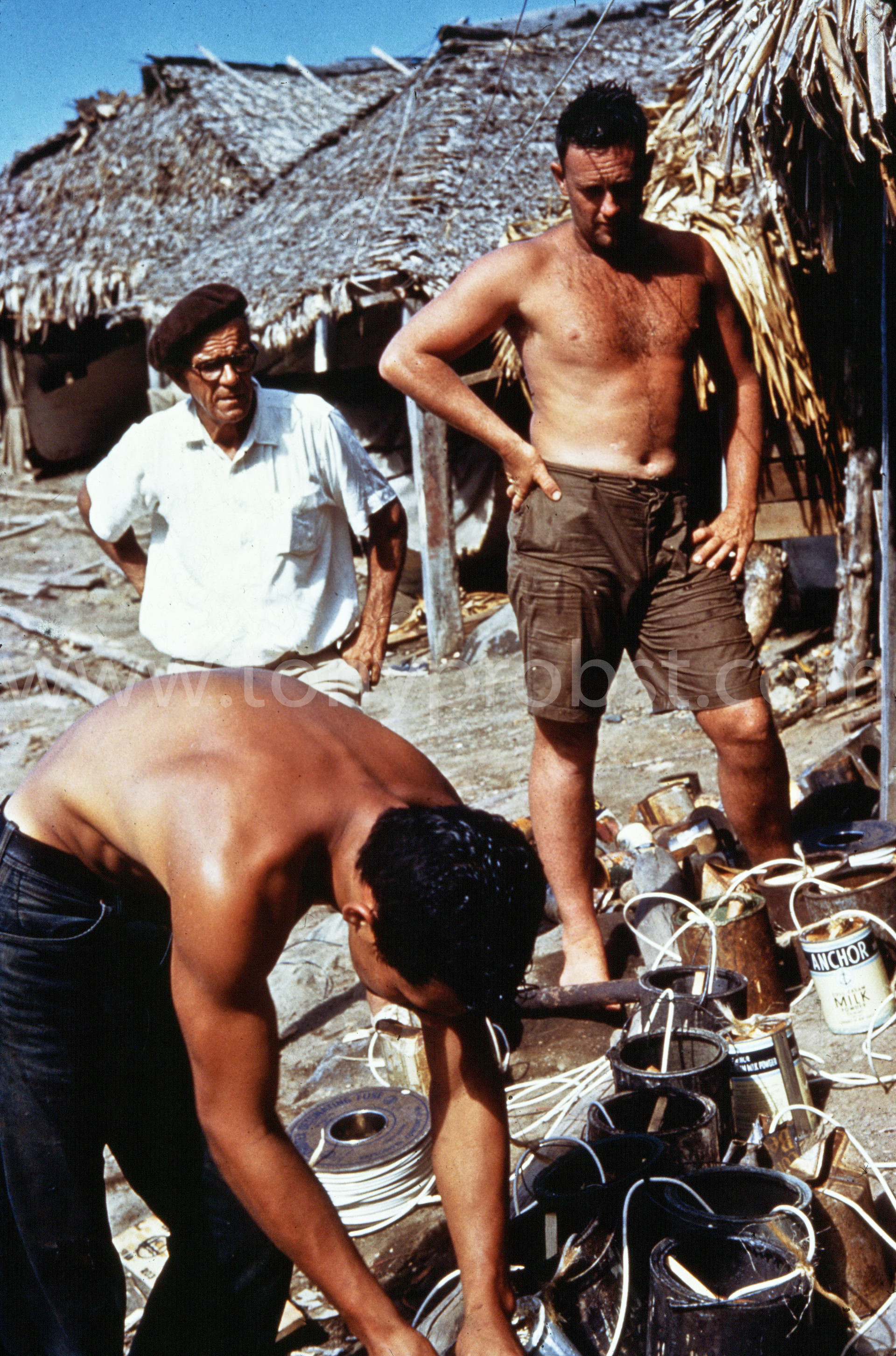 1962 Brandon from Fiji in white. Kean bending over. Charles standing. Paid 2 pounds 6 shillings an hour.  Putting together the dynamite to deepen the harbor or blow up Dan