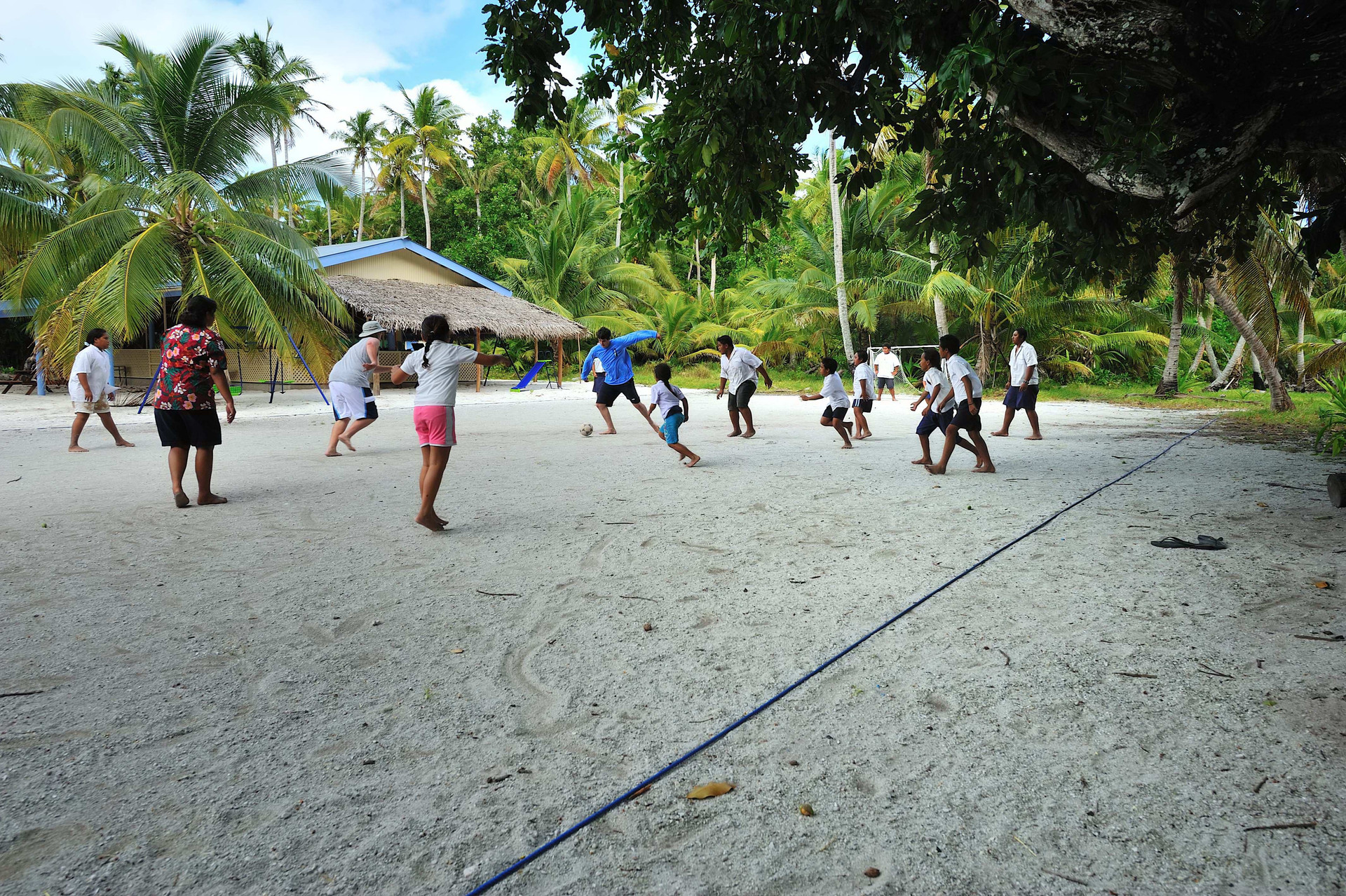 Stephen and Chris Probst playing football with the kids of Palmerston Atoll