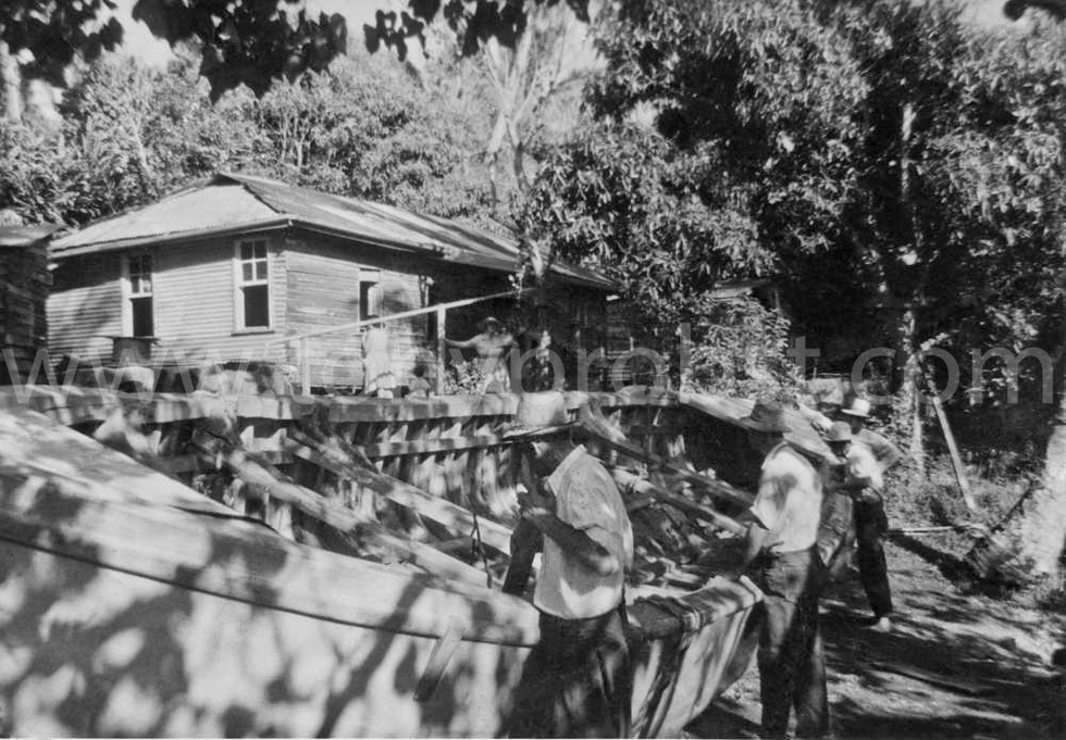 1959 a Finished Longboat ready to  haul to Bounty Bay. Ethel in front of house. Elwin in front Virgil