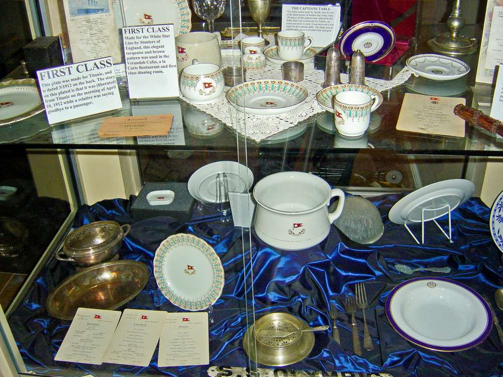 On the top left Titanic Third Class Menu dated April 12 1912. First class china and Spode patter R4332 saucer.  Center bottom shelve large chamber pot. On display in my store in San Rafael, CA