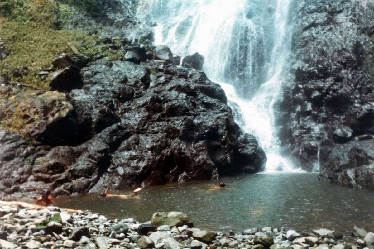 Swimming under a waterfall on Cocos Island May 1972