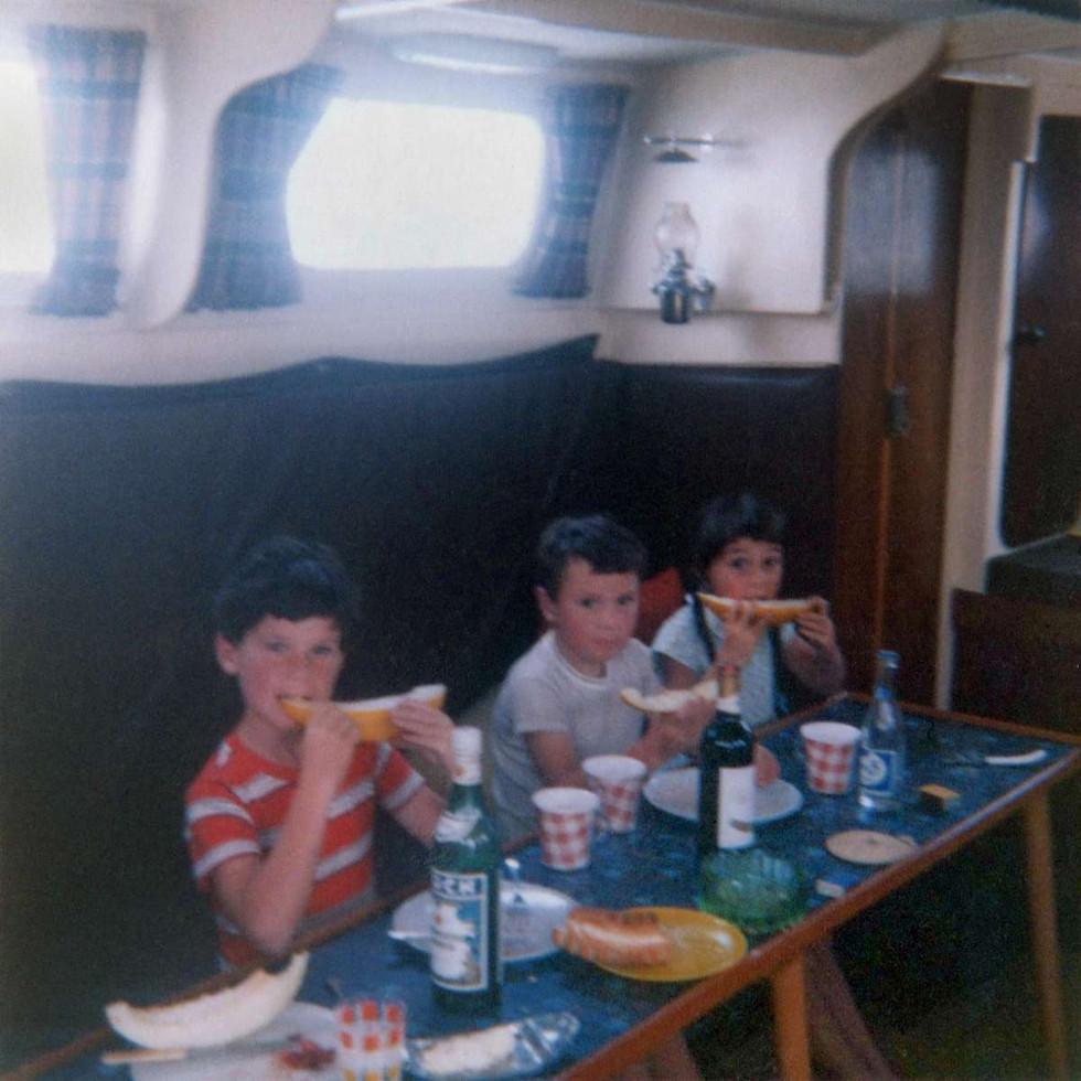 Tony, Andrew and Andrea eating melon at sea