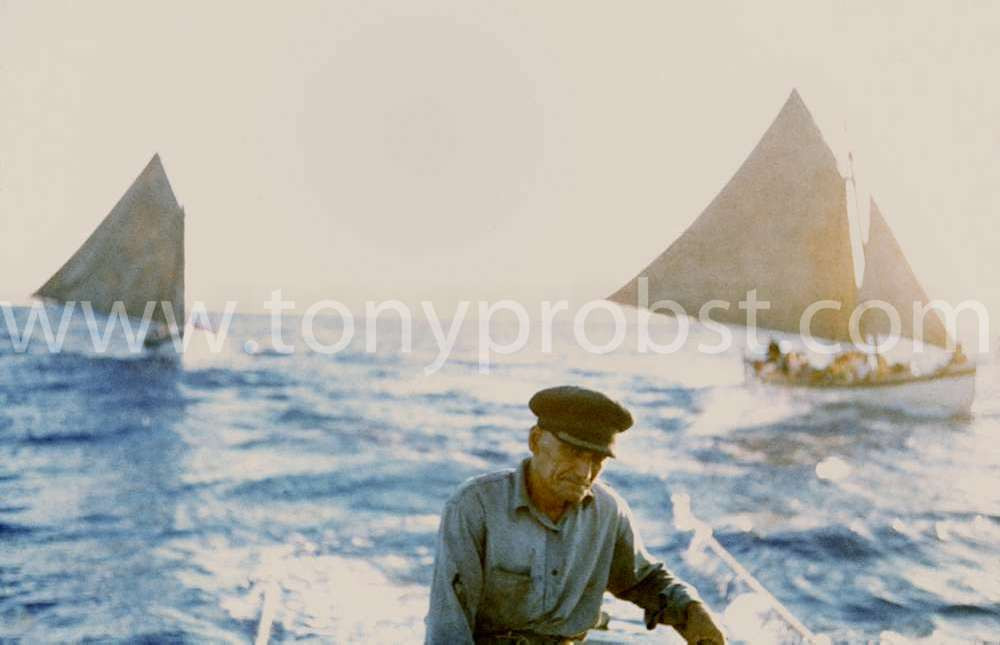 1957 Sailing to Oeno Andrew Young at the helm. Fastest boat would tow the slower boat so they would not separate