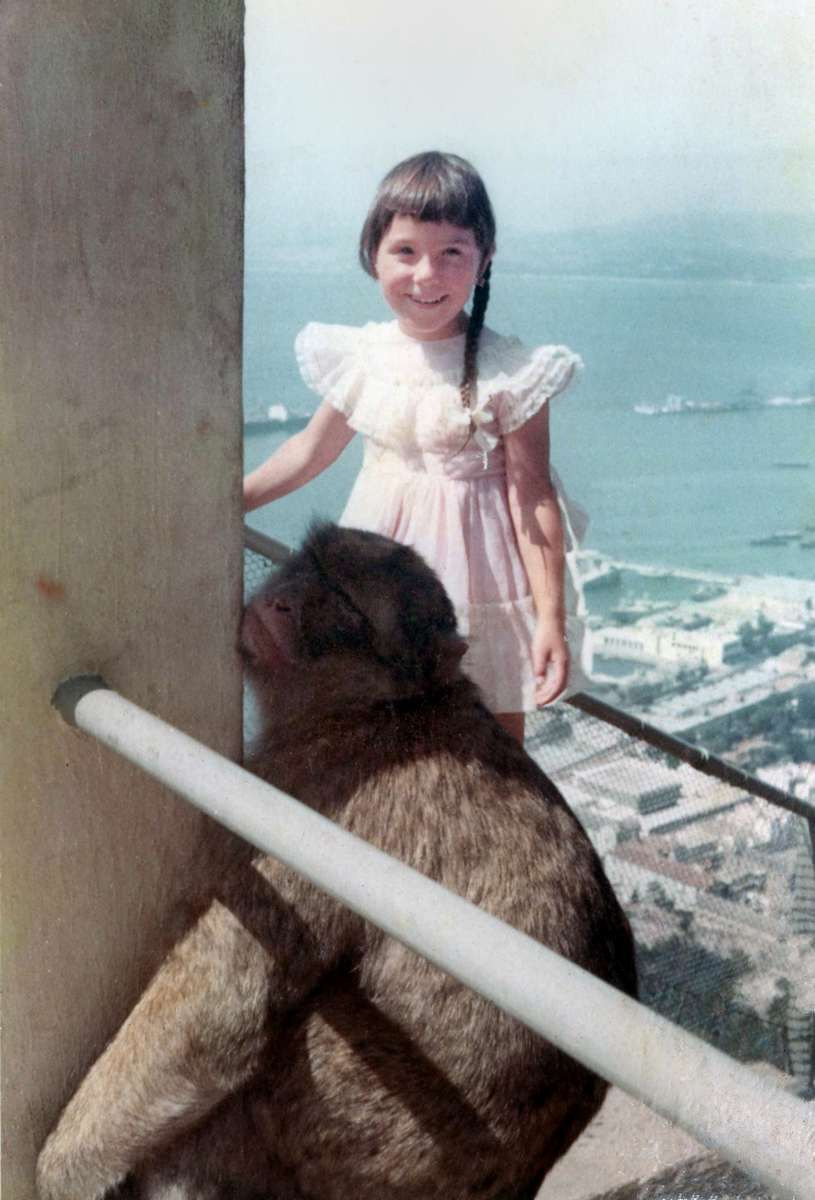 Andrea with an ape on top of the Rock Of Gibraltar