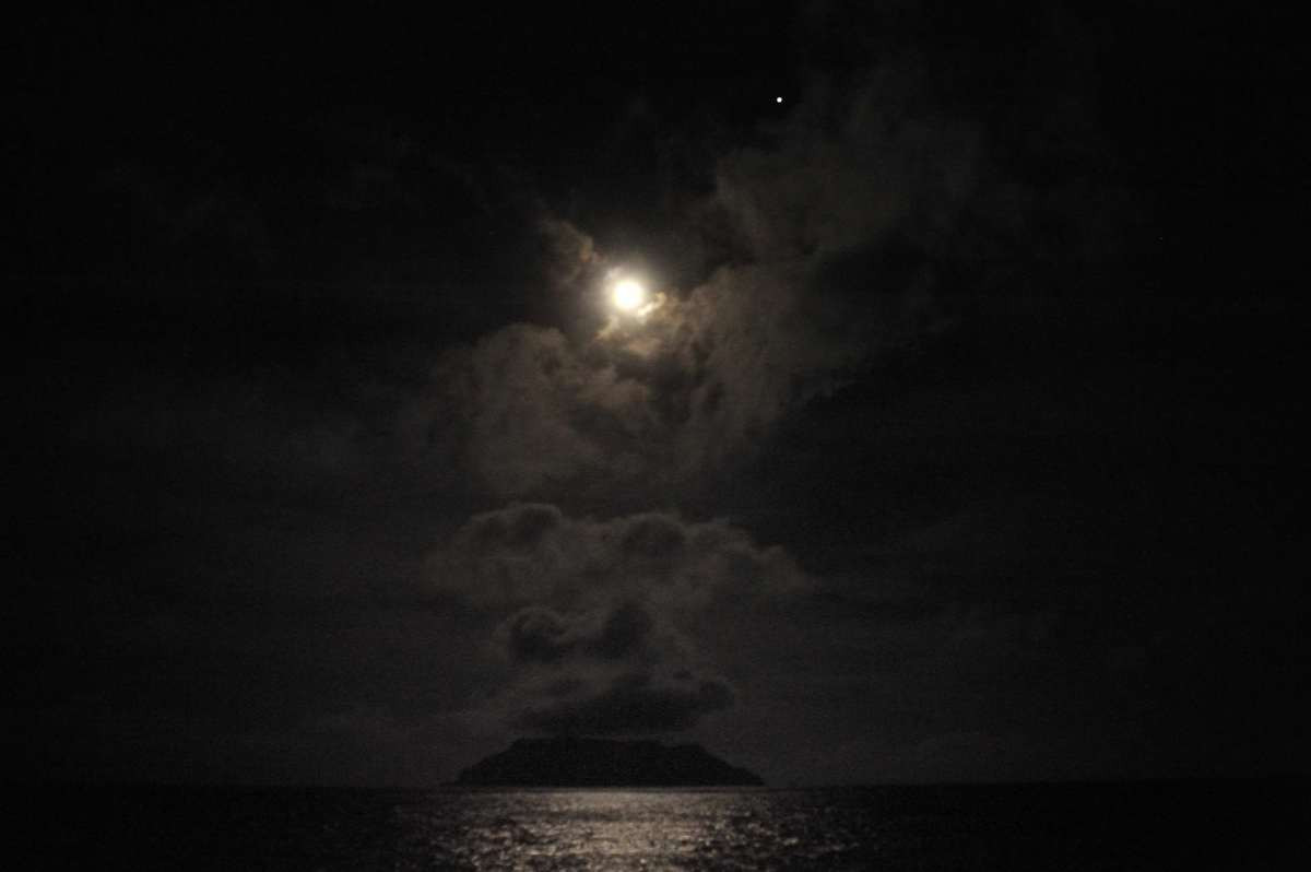 Pitcairn Island lit by the Moon and Venus
