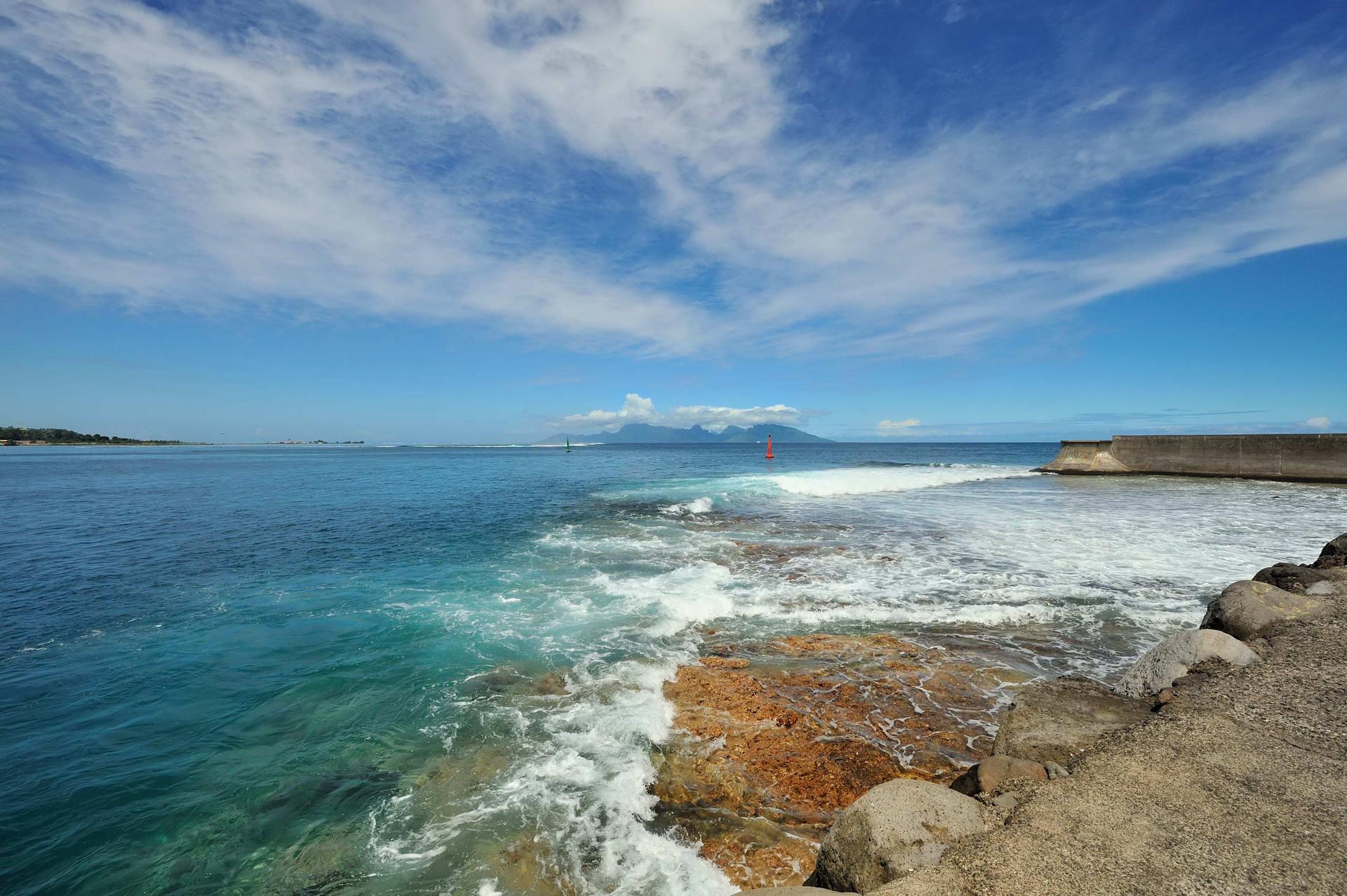 Papeete, Tahiti breakwater looking at Moorea