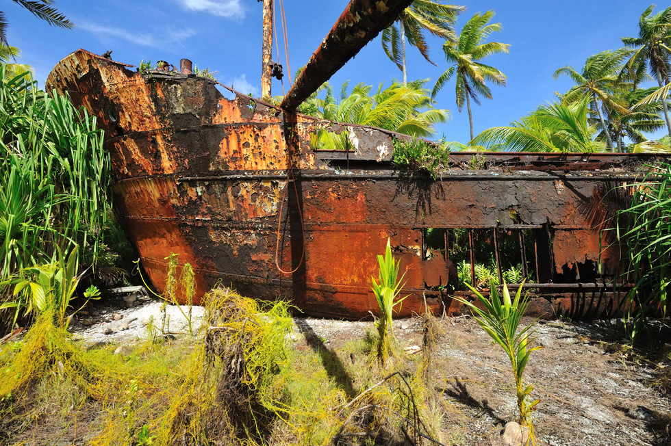 The vessel was holed during attempts to refloat it, and soon after a cyclone lifted it up and it landed upright in the middle of the island where it remains to this day...rusting among the palm trees.