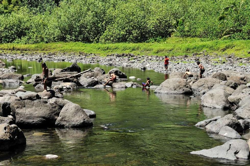 Children playing in the Papenoo river, Tahiti