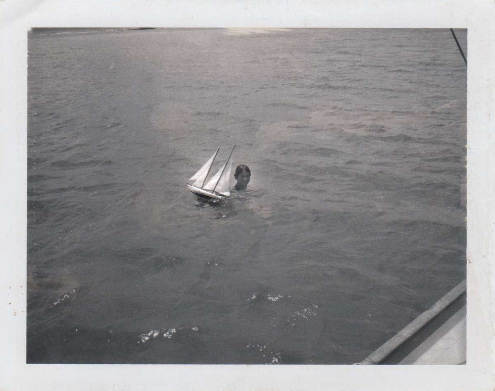 Tony with a model sailing boat he made in Tortola, British Virgin islands in October 1968